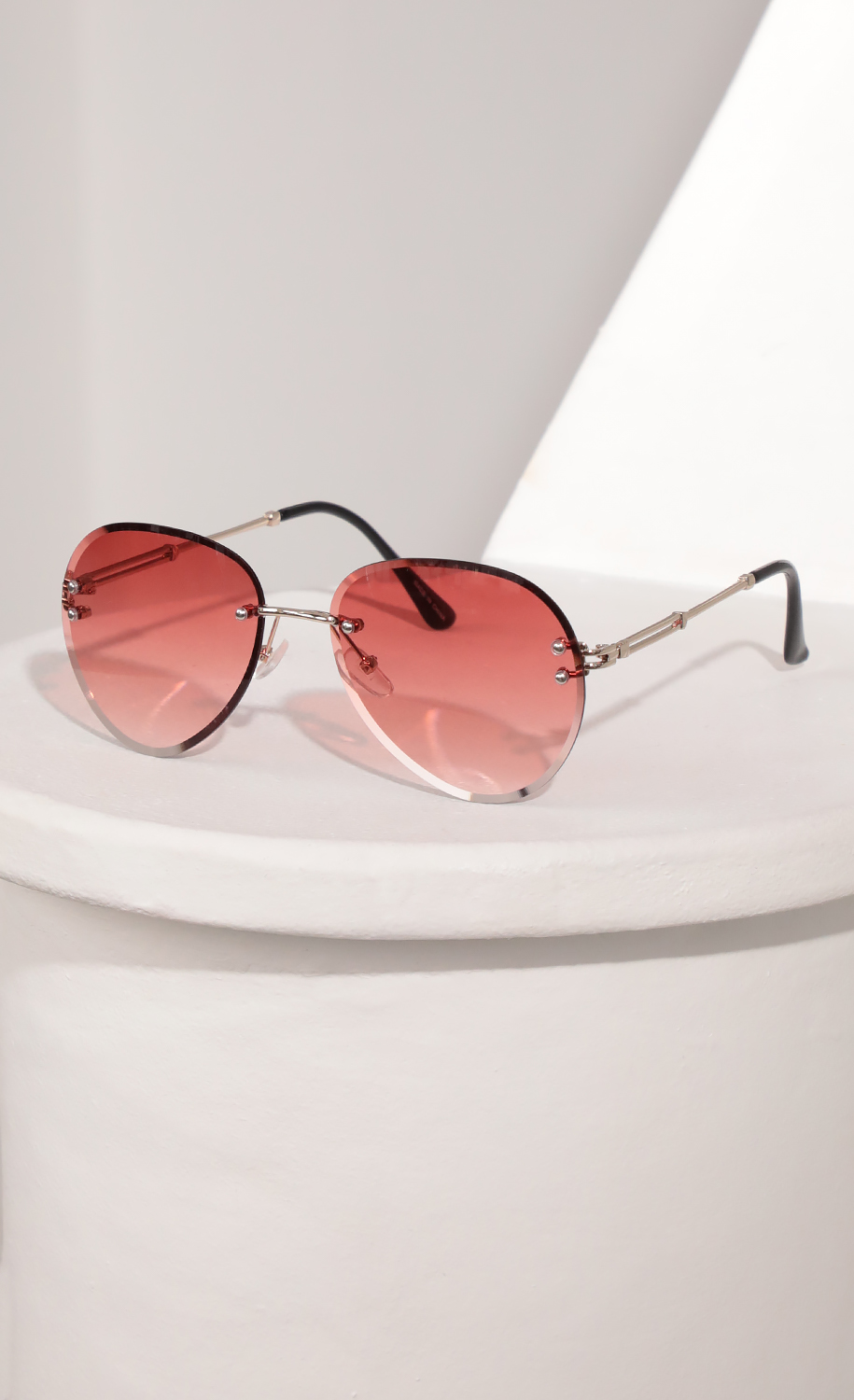 Rimless Aviator-Inspired Sunglasses in Coral