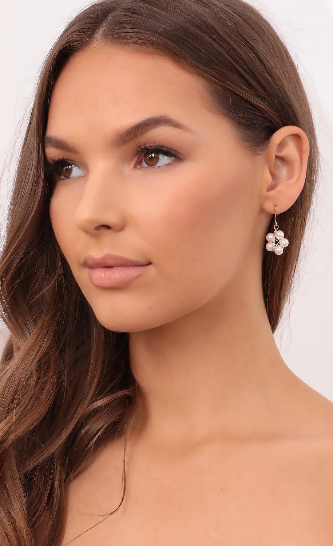 Growing Pearls Dangle Earrings in Gold